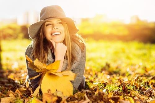 Happy girl enjoying a fall day