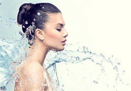 beautiful smiling girl under splash of water with fresh skin-img-blog
